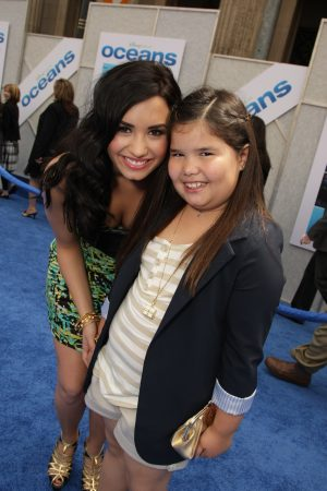 Demi Lovato and her sister Madison on the red carpet