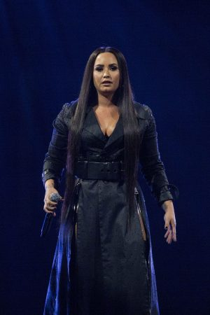 Demi Lovato singing on stage in London 2018