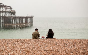 Couple having a picnic on Brighton seafront