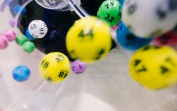 Yellow, white, green, purple and blue lottery balls spinning