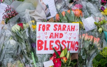 """Flowers and sign saying """"for Sarah and blessing""""."""