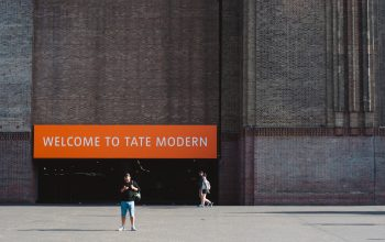 """The entrance of Tate Modern with a banner stating """"Welcome to Tate Modern""""."""